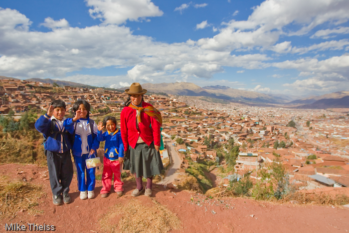 Cusco Peru  city images : Photo of Peruvian family overlooking the city of Cusco, Peru